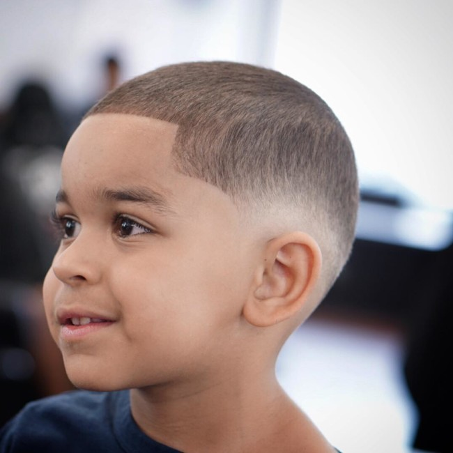 Buzz cut + Burst Fade Hairstyle for black boy